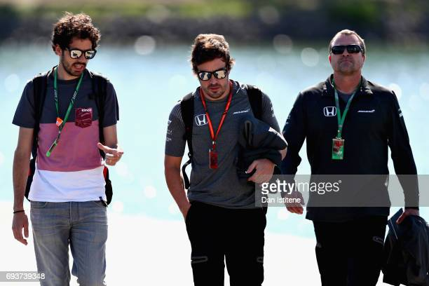 Fernando Alonso of Spain and McLaren Honda walks into the paddock during previews for the Canadian Formula One Grand Prix at Circuit Gilles...