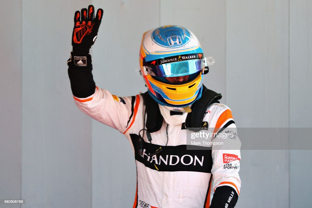 Fernando Alonso of Spain and McLaren Honda waves to the crowd after qualifying in 7th position on the grid during qualifying for the Spanish Formula One Grand Prix at Circuit de Catalunya on May 13, 2017 in Montmelo, Spain.