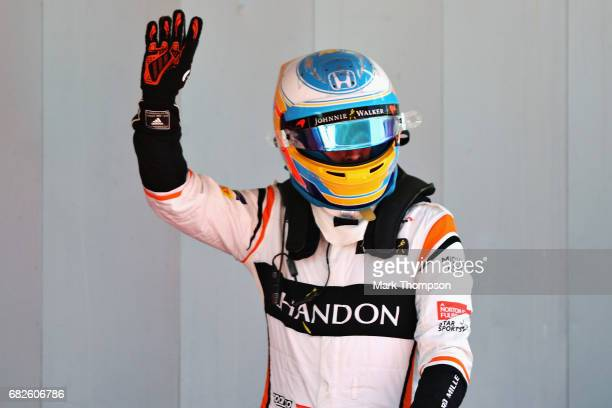 Fernando Alonso of Spain and McLaren Honda waves to the crowd after qualifying in 7th position on the grid during qualifying for the Spanish Formula...