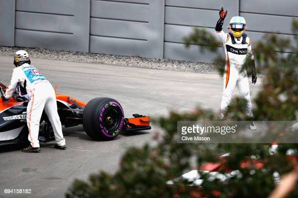 Fernando Alonso of Spain and McLaren Honda waves to the crowd after his car stopped on track during practice for the Canadian Formula One Grand Prix...