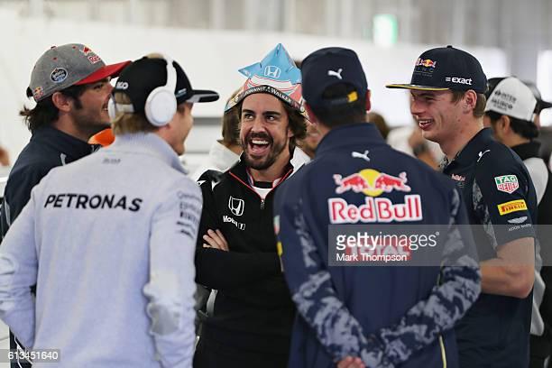 Fernando Alonso of Spain and McLaren Honda with Nico Rosberg of Germany and Mercedes GP Daniel Ricciardo of Australia and Red Bull Racing Max...