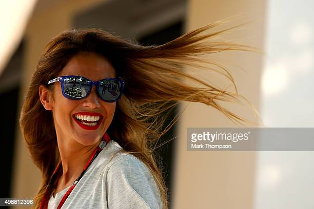 Fernando Alonso of Spain and McLaren Honda's girlfriend Lara Alvarez looks on in the paddock during previews for the Abu Dhabi Formula One Grand Prix...
