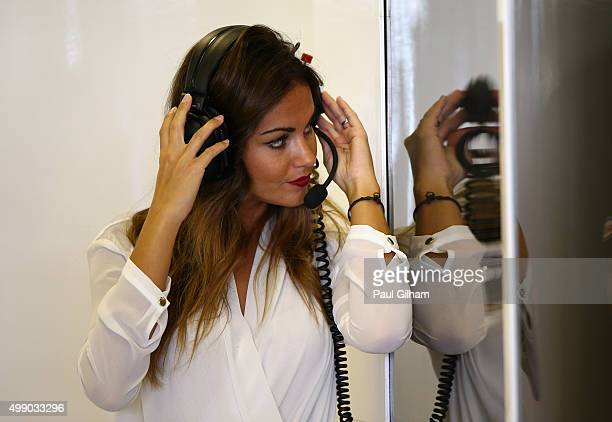 Fernando Alonso of Spain and McLaren Honda's girlfriend Lara Alvarez in the team garage during final practice for the Abu Dhabi Formula One Grand...