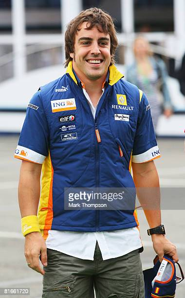 Fernando Alonso of Spain and Renault attends the drivers parade before the French Formula One Grand Prix at the Circuit de Nevers MagnyCours on June...