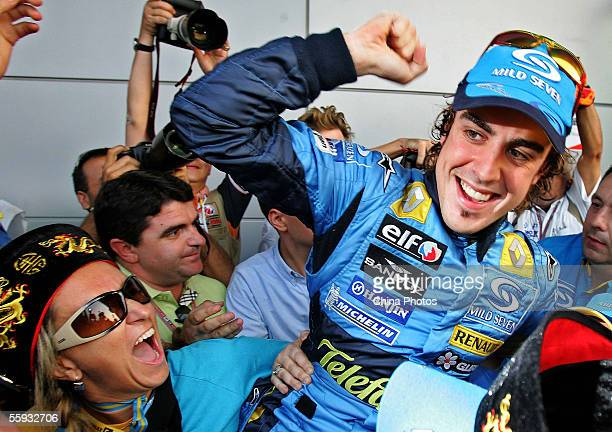 Fernando Alonso of Spain and Renault celebrates after winning the Chinese F1 Grand Prix resulting in Renault winning the Constructors championship at...