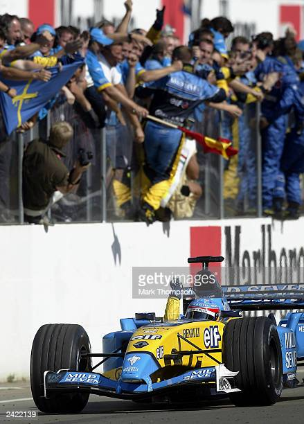 Fernando Alonso of Spain and Renault celebrates as he crosses the line to win the Formula One Hungarian Grand Prix at the Hungaroring on August 24...