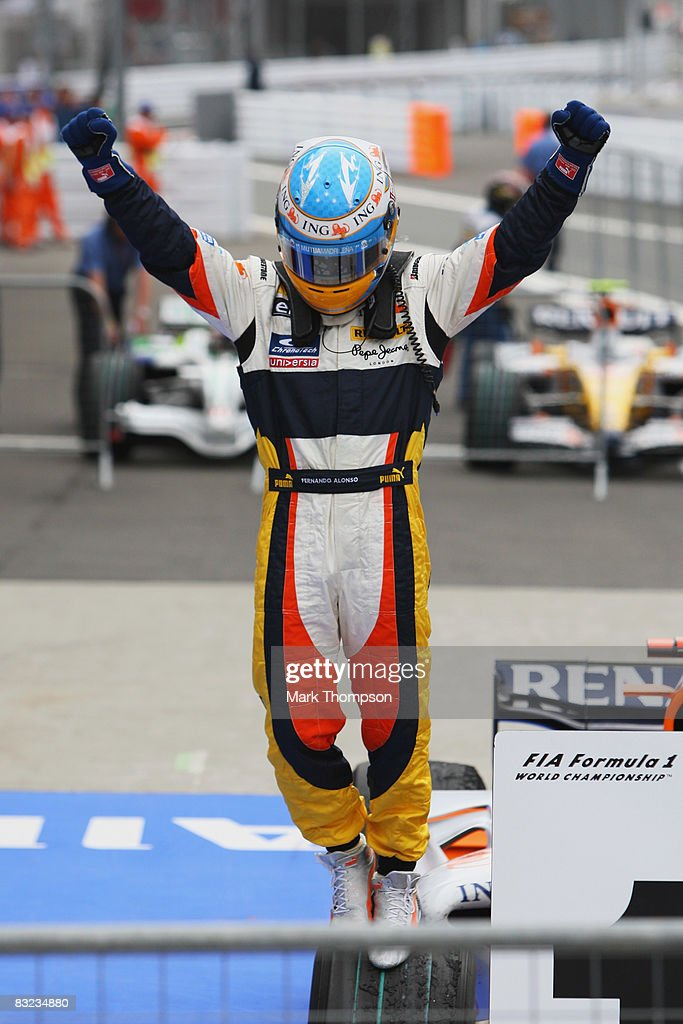 Fernando Alonso of Spain and Renault celebrates in parc ferme after winning the Japanese Formula One Grand Prix at the Fuji Speedway on October 12, 2008 in Shizuoka, Japan.