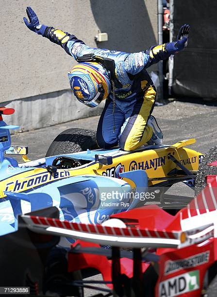 Fernando Alonso of Spain and Renault celebrates on his car after winning the Canadian Formula One Grand Prix at the GillesVilleneuve Circuit on June...