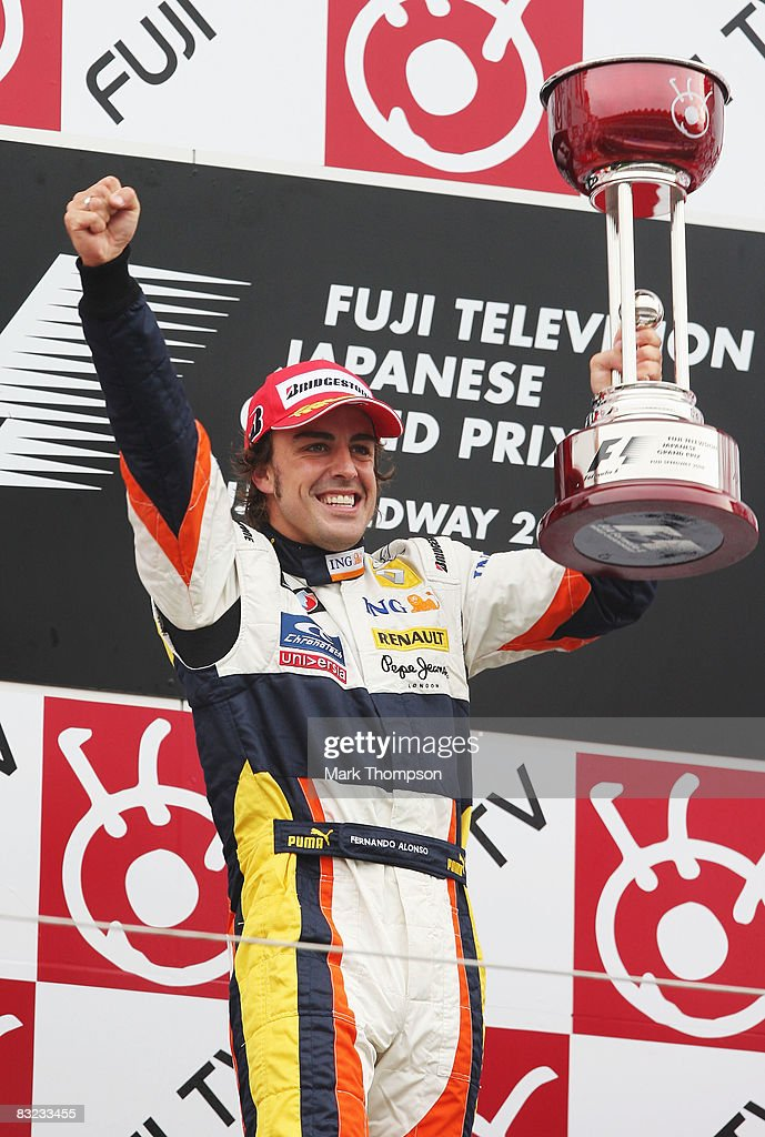 Fernando Alonso of Spain and Renault celebrates on the podium after winning the Japanese Formula One Grand Prix at the Fuji Speedway on October 12, 2008 in Shizuoka, Japan.
