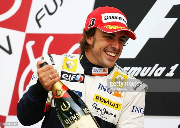 Fernando Alonso of Spain and Renault celebrates on the podium after winning the Japanese Formula One Grand Prix at the Fuji Speedway on October 12...