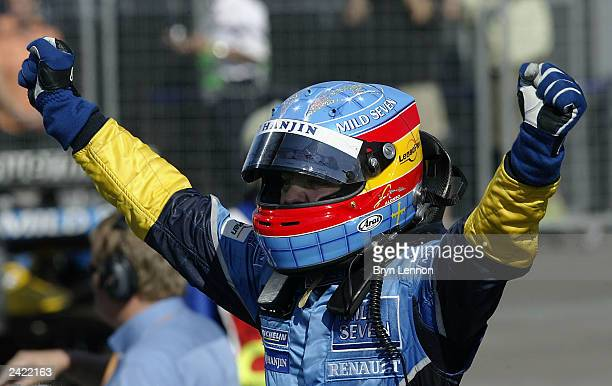 Fernando Alonso of Spain and Renault celebrates winning the Formula One Hungarian Grand Prix at the Hungaroring on August 24 2003 in Budapest Hungary