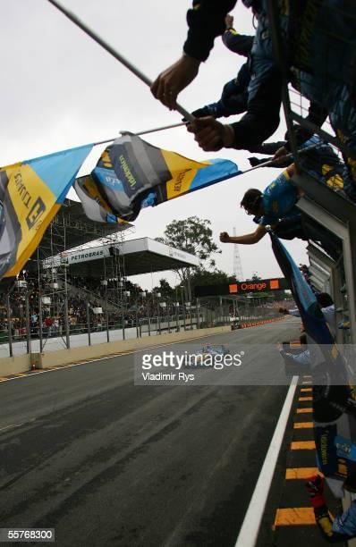 Fernando Alonso of Spain and Renault celebrates winning the World Championship after winning the Brazilian F1 Grand Prix at the Autodromo Interlagos...