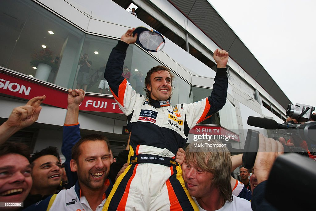 Fernando Alonso of Spain and Renault celebrates with his team mates after winning the Japanese Formula One Grand Prix at the Fuji Speedway on October 12, 2008 in Shizuoka, Japan.