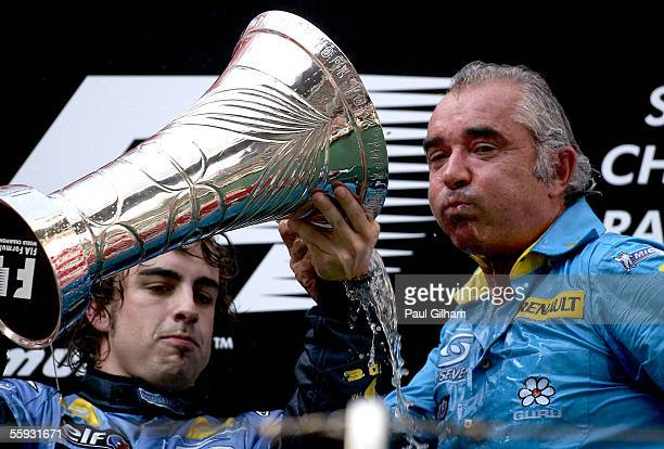 Fernando Alonso of Spain and Renault celebrates with Team principal Flavio Briatore after winning the Chinese F1 Grand Prix resulting in Renault...
