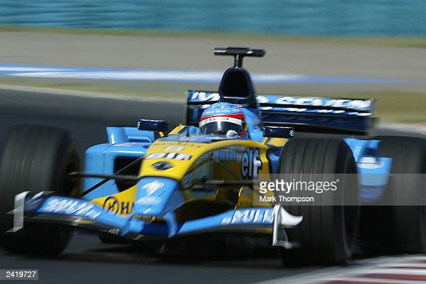 Fernando Alonso of Spain and Renault in action during second practice for the Formula One Hungarian Grand Prix at the Hungaroring on August 23 2003...