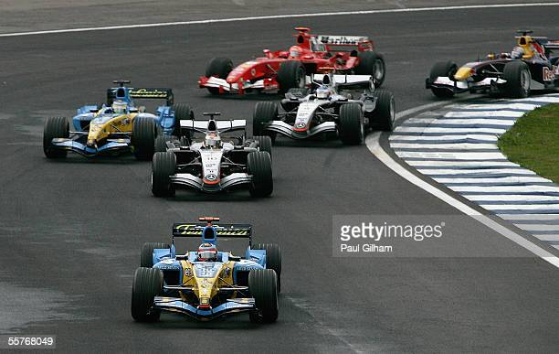 Fernando Alonso of Spain and Renault leads the pack into the second corner during the Brazilian F1 Grand Prix at the Autodromo Interlagos on...