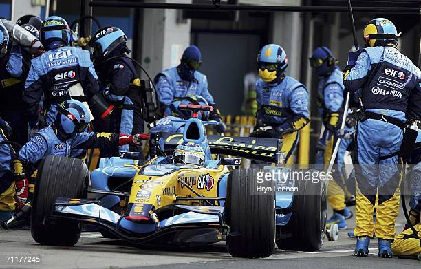 Fernando Alonso of Spain and Renault makes a pit stop during the F1 British Grand Prix on June 11 2006 at Silverstone England