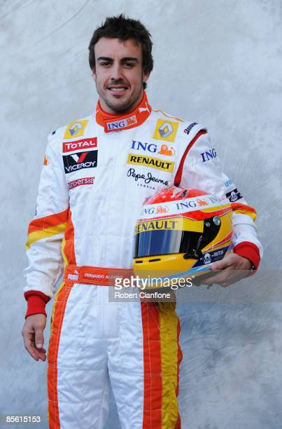 Fernando Alonso of Spain and Renault poses for photographers at the official drivers portrait session during previews to the Australian Formula One...