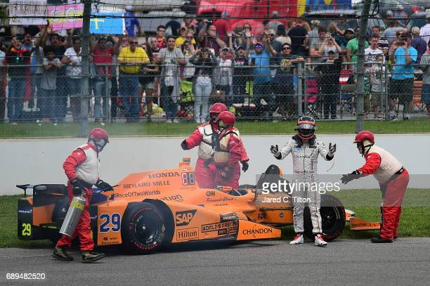 Fernando Alonso of Spain driver of the McLarenHondaAndretti Honda exits his car after his engine expired during the 101st Indianapolis 500 at...