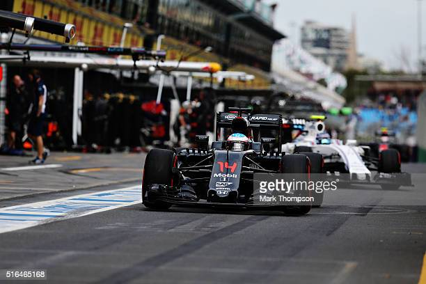 Fernando Alonso of Spain drives the McLaren Honda Formula 1 Team McLaren MP431 Honda RA616H Hybrid turbo in the Pitlane during qualifying for the...