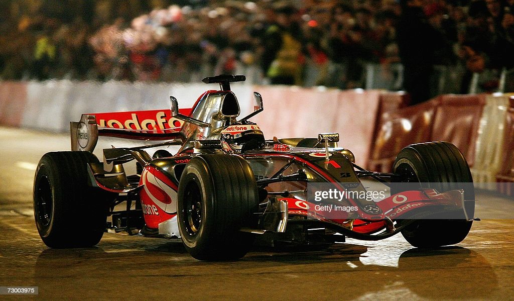 Fernando Alonso of Spain drives the Vodafone McLaren Mercedes on the streets during the launch of the Vodafone McLaren Mercedes 2007 MP422 F1...