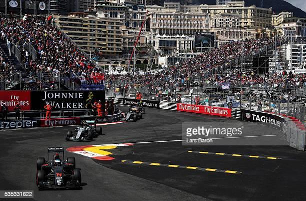 Fernando Alonso of Spain driving the McLaren Honda Formula 1 Team McLaren MP431 Honda RA616H Hybrid turbo on track ahead of Nico Rosberg of Germany...