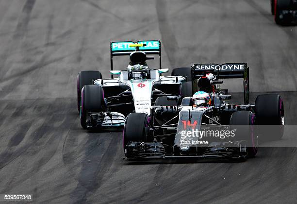 Fernando Alonso of Spain driving the McLaren Honda Formula 1 Team McLaren MP431 Honda RA616H Hybrid turbo leads Nico Rosberg of Germany driving the...
