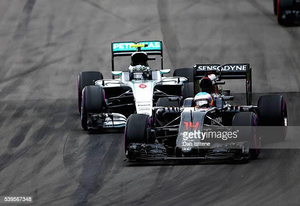 Fernando Alonso of Spain driving the McLaren Honda Formula 1 Team McLaren MP431 Honda RA616H Hybrid turbo leads Nico Rosberg of Germany driving the...
