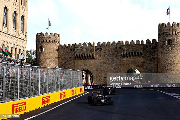Fernando Alonso of Spain driving the McLaren Honda Formula 1 Team McLaren MP431 Honda RA616H Hybrid turbo leads Jenson Button of Great Britain...