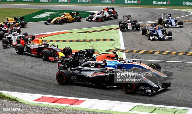 Fernando Alonso of Spain driving the McLaren Honda Formula 1 Team McLaren MP431 Honda RA616H Hybrid turbo and Pascal Wehrlein of Germany driving the...