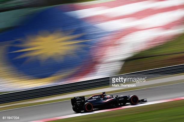 Fernando Alonso of Spain driving the McLaren Honda Formula 1 Team McLaren MP431 Honda RA616H Hybrid turbo on track during the Malaysia Formula One...