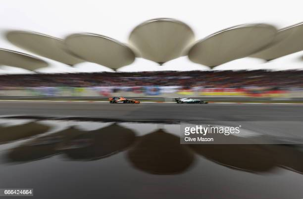 Fernando Alonso of Spain driving the McLaren Honda Formula 1 Team McLaren MCL32 beind Valtteri Bottas driving the Mercedes AMG Petronas F1 Team...