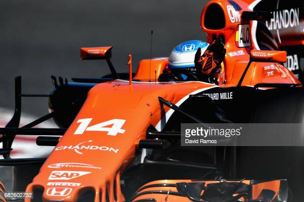 Fernando Alonso of Spain driving the McLaren Honda Formula 1 Team McLaren MCL32 waves to the crowd after qualifying in 7th position on the grid...