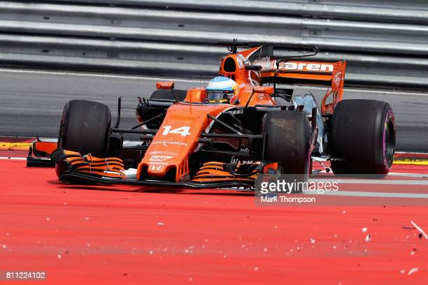 Fernando Alonso of Spain driving the McLaren Honda Formula 1 Team McLaren MCL32 faces the wrong way after being caught up in a collision at the start...