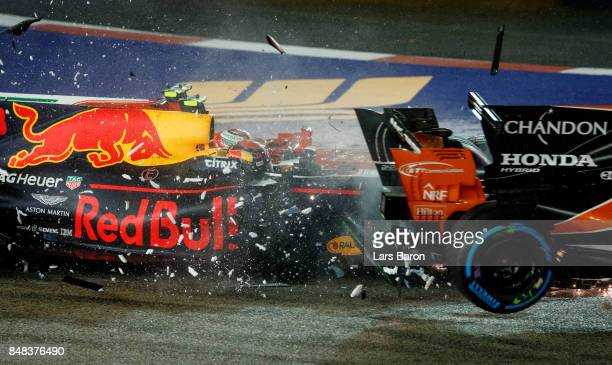 Fernando Alonso of Spain driving the McLaren Honda Formula 1 Team McLaren MCL32 Kimi Raikkonen of Finland driving the Scuderia Ferrari SF70H and Max...