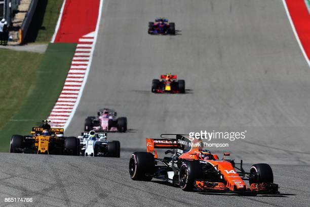 Fernando Alonso of Spain driving the McLaren Honda Formula 1 Team McLaren MCL32 leads Carlos Sainz of Spain driving the Renault Sport Formula One...