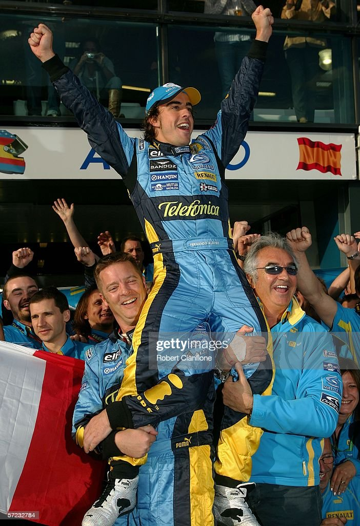 Fernando Alonso of Spain is lifted onto the shoulders of Renault team principal Flavio Briatore as they celebrates winning the Australian Formula One...