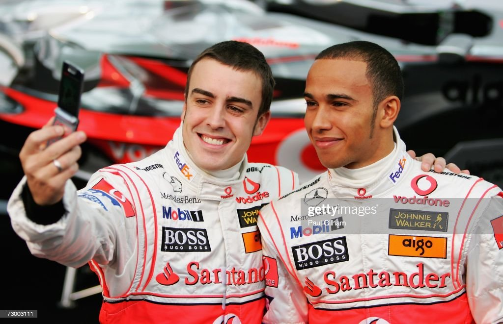 Fernando Alonso of Spain takes a picture of teammate Lewis Hamilton of Great Britain during the launch of the Vodafone McLaren Mercedes 2007 MP422 F1...