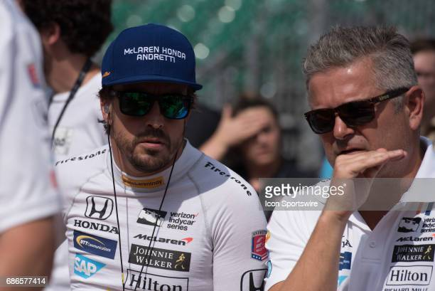 Fernando Alonso with Gil de Ferran on the first day of qualifications for the 101st Indianapolis on May 20 at the Indianapolis Motor Speedway in...