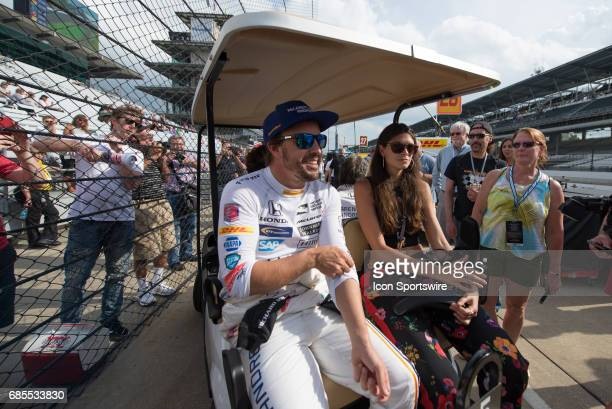 Fernando Alonso with his girlfriend model Linda Morselli on the fifth day of practice for the 101st Indianapolis on May 19 at the Indianapolis Motor...