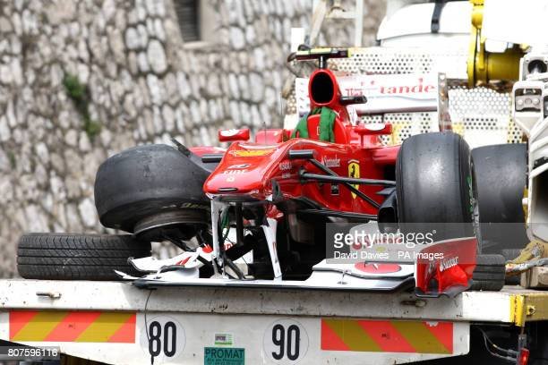 Fernando Alonso's Ferrari is driven away on the back of a truck after crashing in Casino Square during third practice at the Circuit de Monaco Monte...
