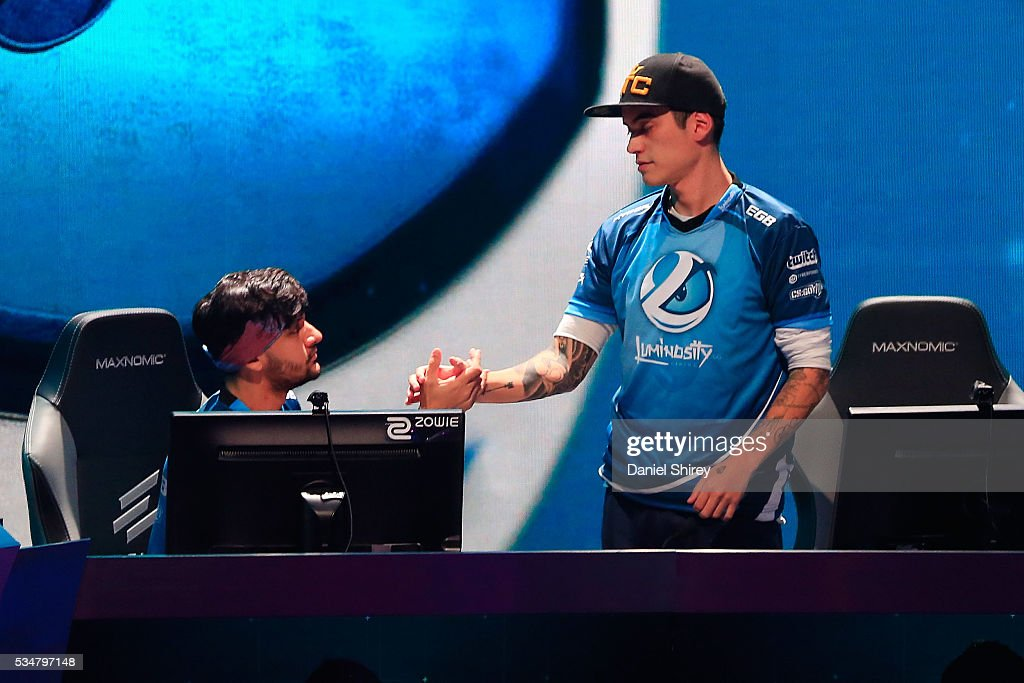Fernando Alvarenga, gamertag fer, and Lincoln Lau, gamertag fnx, of Luminosity celebrate beating Cloud9 at the ELeague Arena at Turner Studios on May 28, 2016 in Atlanta, Georgia.