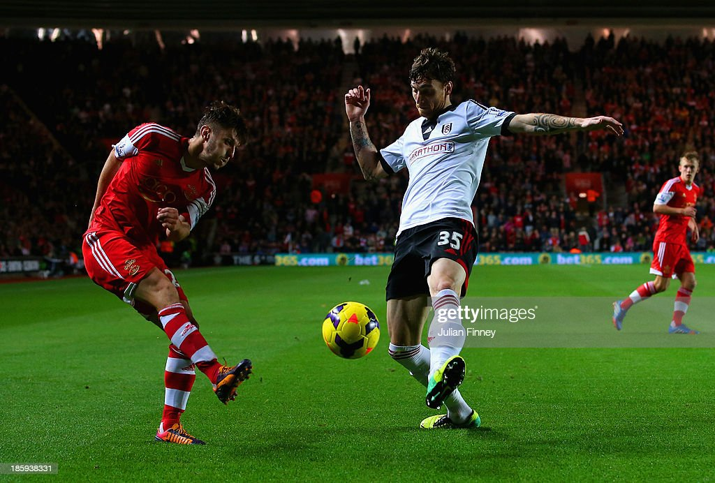 <a gi-track='captionPersonalityLinkClicked' href=/galleries/search?phrase=Fernando+Amorebieta&family=editorial&specificpeople=866883 ng-click='$event.stopPropagation()'>Fernando Amorebieta</a> of Fulham blocks a cross from <a gi-track='captionPersonalityLinkClicked' href=/galleries/search?phrase=Adam+Lallana&family=editorial&specificpeople=5475862 ng-click='$event.stopPropagation()'>Adam Lallana</a> of Southampton during the Barclays Premier League match between Southampton and Fulham at St Mary's Stadium on October 26, 2013 in Southampton, England.
