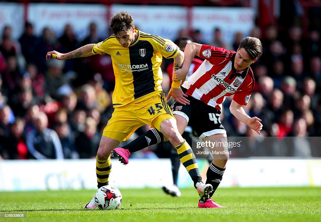 Fernando Amorebieta of Fulham tackles with Sergi Canos of Brentford during the Sky Bet Championship match between Brentford and Fulham at Griffin Park on April 30, 2016 in Brentford, England.