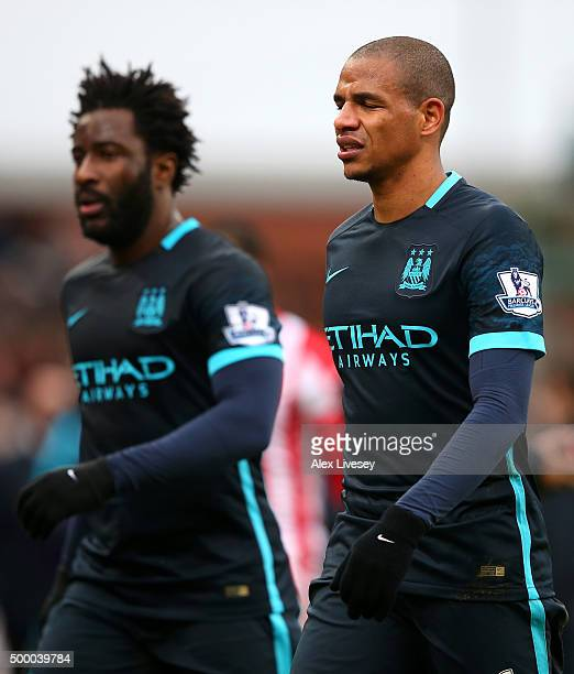 Fernando and Wilfred Bony of Manchester City leave the pitch at the halftime during the Barclays Premier League match between Stoke City and...