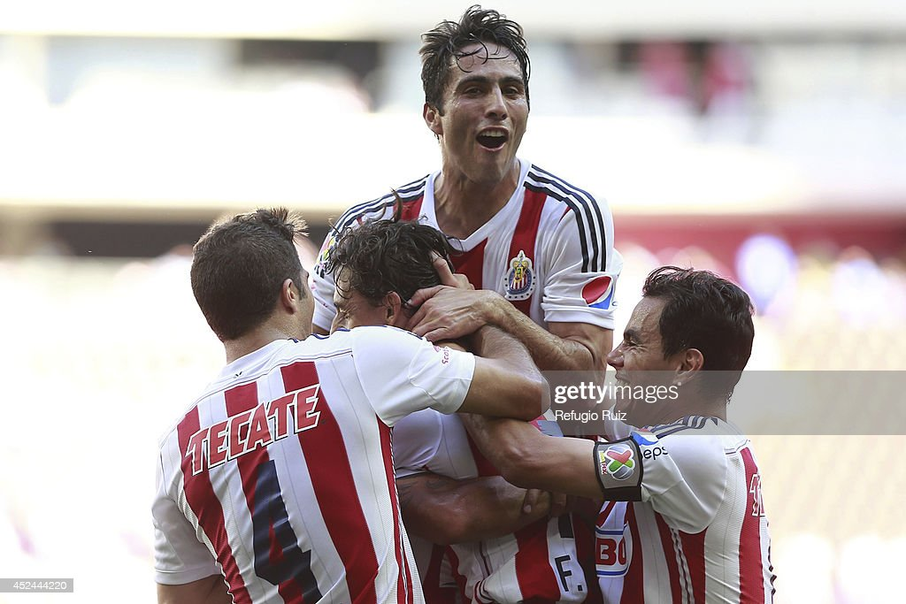 <a gi-track='captionPersonalityLinkClicked' href=/galleries/search?phrase=Fernando+Arce&family=editorial&specificpeople=697001 ng-click='$event.stopPropagation()'>Fernando Arce</a> of Chivas celebrates a scored goal with teammates during a match between Chivas and Jaguares as part of 1st round Apertura 2014 Liga MX at Omnilife Stadium on July 20, 2014 in Guadalajara, Mexico.