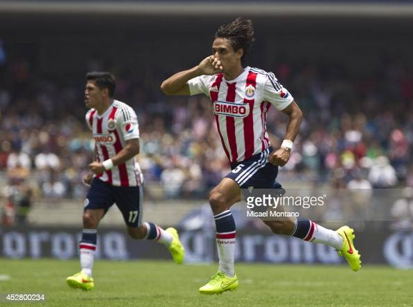 Fernando Arce of Chivas celebrates after scoring the opening goal against Pumas during a match between Pumas and Chivas as part of 2nd round Apertura...