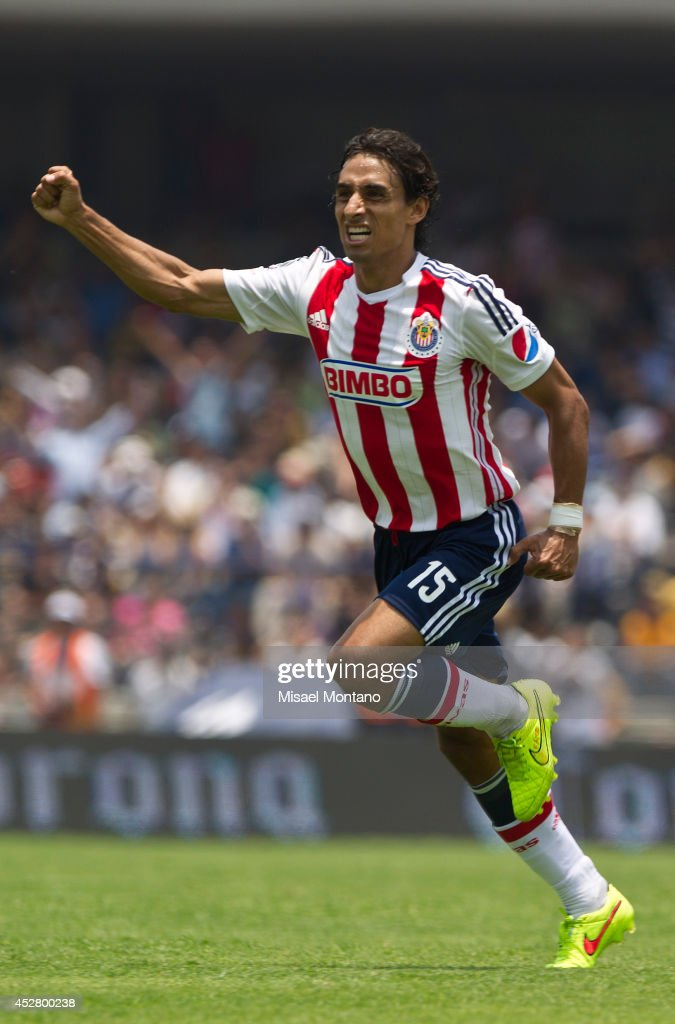 <a gi-track='captionPersonalityLinkClicked' href=/galleries/search?phrase=Fernando+Arce&family=editorial&specificpeople=697001 ng-click='$event.stopPropagation()'>Fernando Arce</a> of Chivas celebrates after scoring the opening goal against Pumas during a match between Pumas and Chivas as part of 2nd round Apertura 2014 Liga MX at University Olympic Stadium on July 27, 2014 in Mexico City, Mexico.