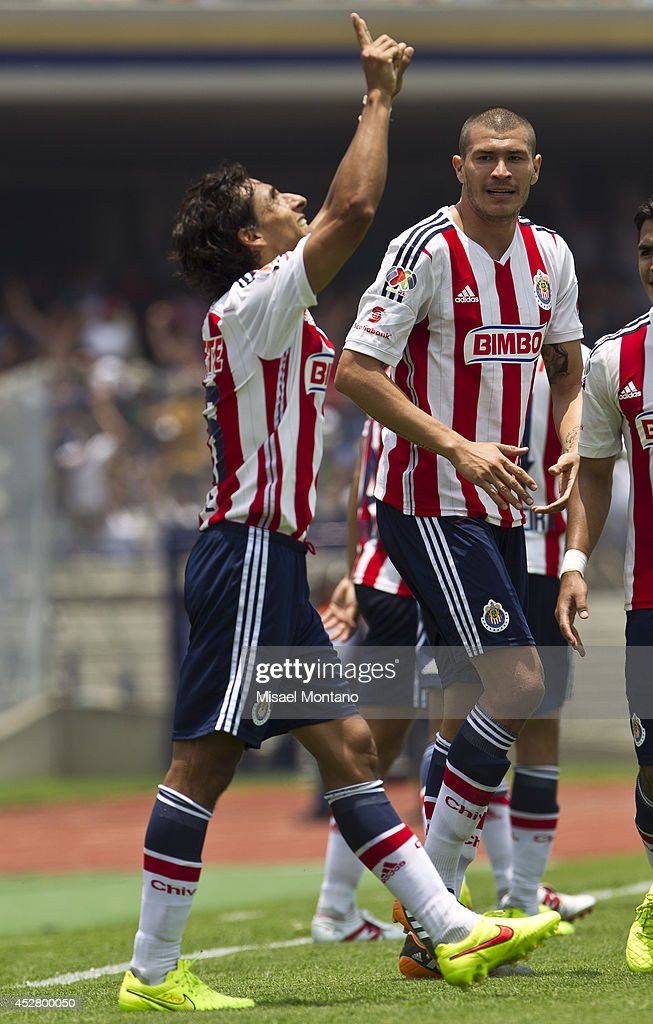 <a gi-track='captionPersonalityLinkClicked' href=/galleries/search?phrase=Fernando+Arce&family=editorial&specificpeople=697001 ng-click='$event.stopPropagation()'>Fernando Arce</a> of Chivas celebrates with his teammates after scoring the first goal against Pumas during a match between Pumas and Chivas as part of 2nd round Apertura 2014 Liga MX at University Olympic Stadium on July 27, 2014 in Mexico City, Mexico.