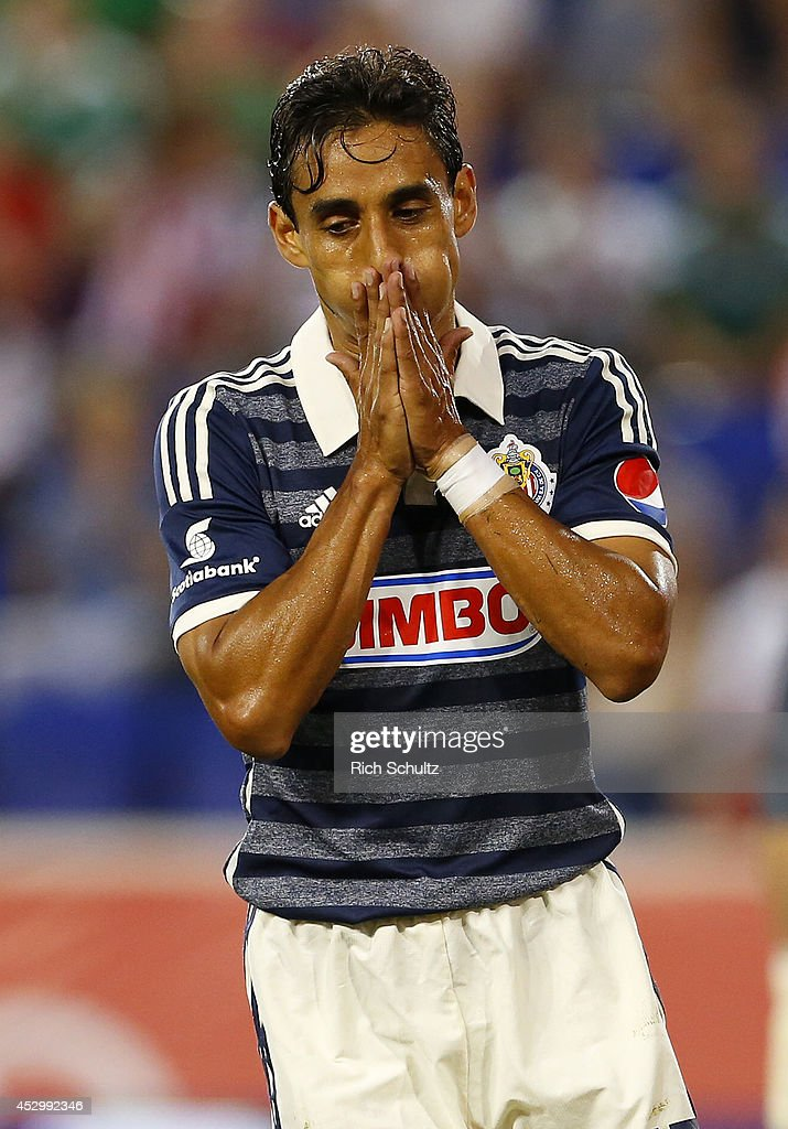 <a gi-track='captionPersonalityLinkClicked' href=/galleries/search?phrase=Fernando+Arce&family=editorial&specificpeople=697001 ng-click='$event.stopPropagation()'>Fernando Arce</a> #15 of Chivas reacts to missing a goal during a friendly match against Bayern Munich at Red Bull Arena on July 31, 2014 in Harrison, United States.